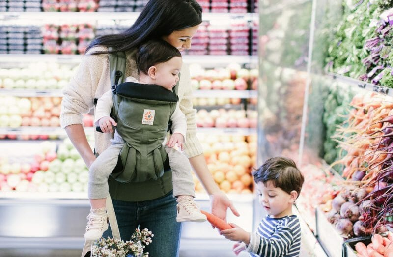 A baby facing forward in an Omni 360 Baby Carrier