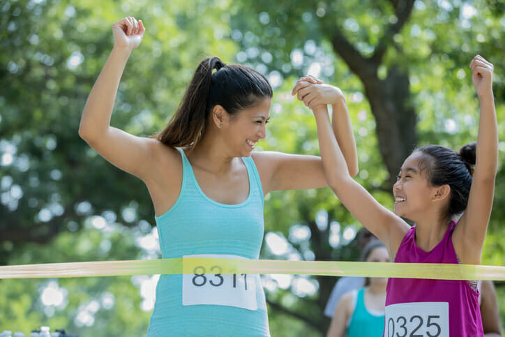 mother and daughter finish a race
