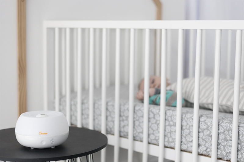 humidifier next to baby in crib