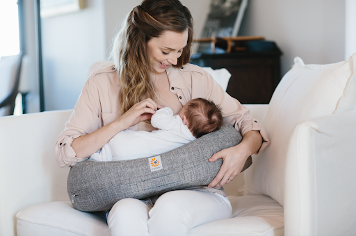 mom nursing with Ergobaby nursing pillow