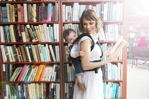 woman carrying baby on her back with Ergobaby carrier