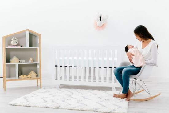 Woman sitting in nursery with baby