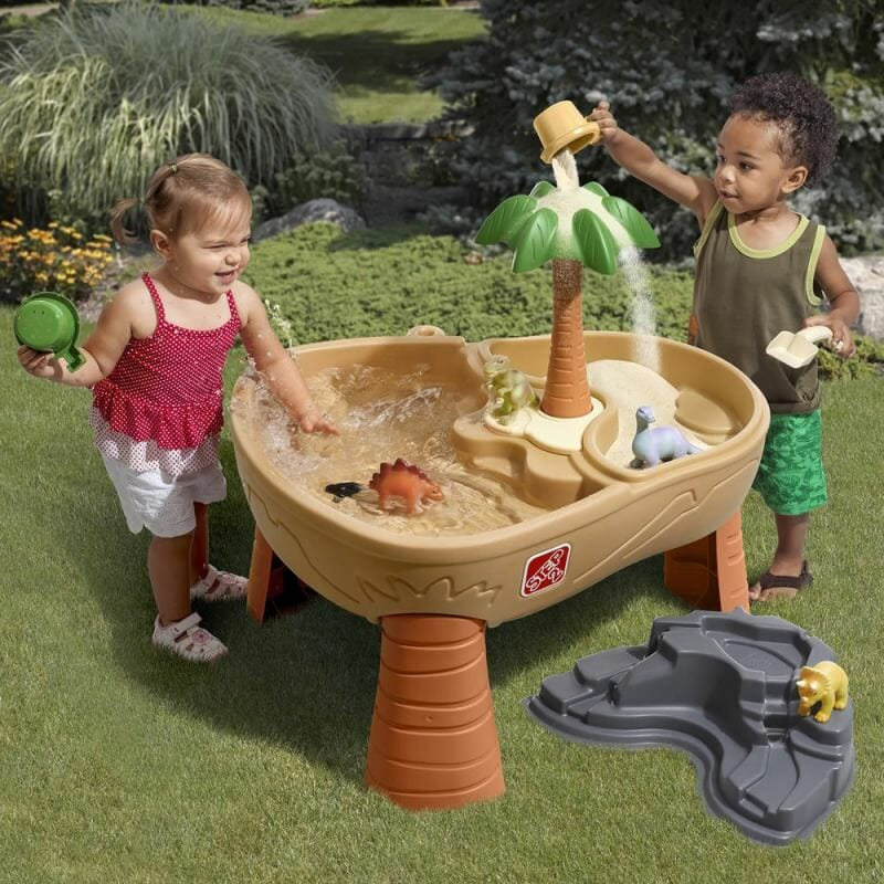 kids playing outside on play table with water