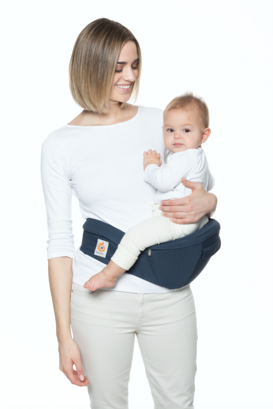 woman holding baby in ergobaby hip seat carrier
