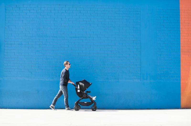 dad pushing baby in stroller